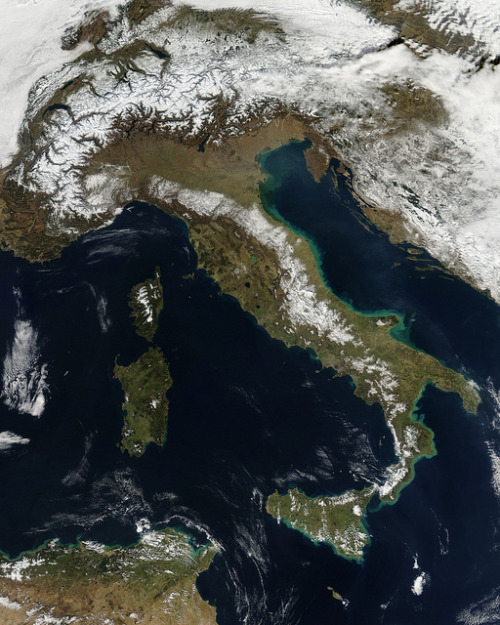 theatlantic:  Picture of the Day: Snowfall Across Italy, From Space  The Moderate Resolution Imaging Spectroradiometer (MODIS) on board NASA'a Aqua satellite captured this picture of Italy last week, shortly after recent snowstorms had blanketed much of the country. The Aqua satellite has been in orbit since 2002, collecting information about all aspects of the Earth's water cycle, including evaporation, clouds, soil moisture, and fluctuations in sea and land ice cover. See more. [Image: NASA]
