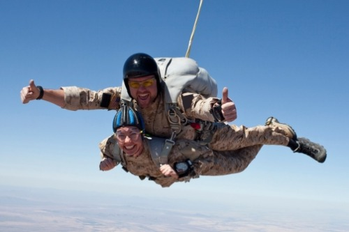 An exclusive photo of Gabby Giffords and a Navy SEAL skydiving in 2009. Sadly, both have been injured by gunfire since. The SEAL was shot just months after the photo in a gunfight with the Taliban in Afghanistan.  Read the full story behind the photo