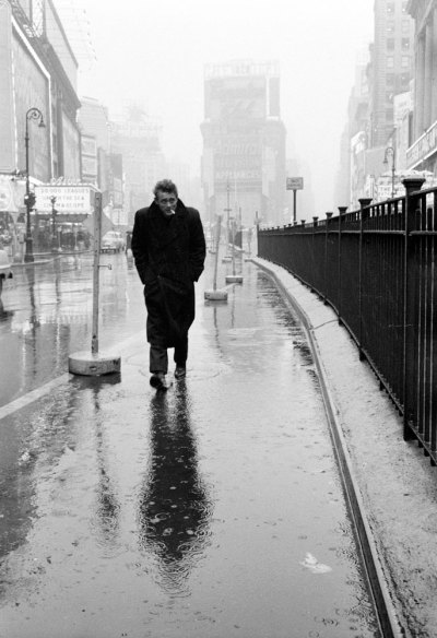 "life:  Hunkering against the cold and rain, a haunted-looking James Dean strolls through Times Square, mere blocks from the famous Actors Studio where he and other legends-to-be studied ""the Method."" Originally published in the March 7, 1955, issue of LIFE. (see more here)"