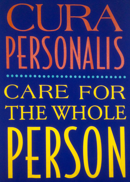 "The Jesuit ideal, Cura Personalis, is a Latin phrase that translates as ""Care for the Whole Person."" This banner is on display in Marquette University's Straz Hall, home to the College of Business Administration."