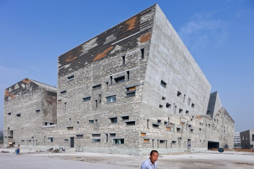 "WANG SHU, 2012 PRITZKER PRIZE Ningbo Historic Museum, Ningbo, China,     					    						 2003-2008. (Iwan Baan) ""The architecture of the 2012 Pritzker Prize Laureate Wang Shu, opens new  horizons while at the same time resonates with place and memory. His  buildings have the unique ability to evoke the past, without making  direct references to history. Born in 1963 and educated in China, Wang  Shu's architecture is exemplary in its strong sense of cultural  continuity and re-invigorated tradition. In works undertaken by the  office he founded with his partner and wife Lu Wenyu, Amateur  Architecture Studio, the past is literally given new life as the  relationship between past and present is explored. The question of the  proper relation of present to past is particularly timely, for the  recent process of urbanization in China invites debate as to whether  architecture should be anchored in tradition or should look only toward  the future. As with any great architecture, Wang Shu´s work is able to  transcend that debate, producing an architecture that is timeless,  deeply rooted in its context and yet universal"". (Jury Citation)"