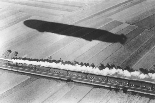 The express train 'Offenburg-Freiburg' and the shadow of the Zeppelin airship 'Schwaben' (LZ 10) taken from the airship. The 'Schwaben' burned on 28/06/1912 in the Golzheimer heath near Dusseldorf.