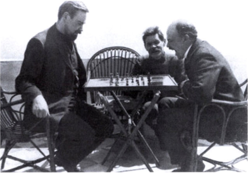 stalins-princess:  Lenin plays chess at the Villa Blaesus on Capri with fellow revolutionary exile Alexander Bogdanov while Maxim Gorky looks on. (1908)