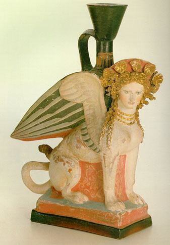 theancientworld:  Lekythos in the Form of Sphinx Late 5th century BC Attica Clay; h 21.5 cm The Hermitage Museum This vessel for perfumed oil, of Attic work, was found not far from Taman in 1869. This superb example of Greek art demonstrates a notable characteristic of art of the Classical period: the form of the rim, neck and handle is that of a lekythos, while the body is executed in the form of a Sphinx – a mythological creature with a lion's body, bird's wings, and a woman's head, with fine facial features and a magnificent head of curly hair.