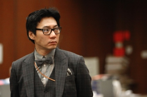 Marlow profiles Pinkberry co-founder Young Lee, who stands accused of beating a homeless man with a tire iron.  Clad in a bespoke suit, bow tie, and designer glasses, Young Lee is a paragon of Angeleno hipness. The urbane 47-year-old is the visionary co-founder of the Pinkberry chain of frozen yogurt shops, responsible for the stores' trademark, pastel-colored minimalist décor—replete with $500 Philippe Starck Victoria Ghost chairs, $300 Le Klint lamps shaped like yogurt swirls, and natural pebbles lining the floor. His passion for aesthetics extends to his 4,799 square-foot 4-bedroom Malibu mansion—an architectural marvel boasting a Boffi kitchen, Toto bidet toilets, and a walk-in closet filled with Hermès. He owns a fleet of luxury cars, including a Rolls-Royce Phantom, Ferrari, and a Mercedes G Wagon. He looks like he's in his early thirties, and enjoys puffing on expensive cigarillos.  But Lee isn't front row at a runway show or gracing a red carpet. On Jan. 30, he's seated inside the uninviting environs of the Los Angeles Superior Court, where Lee is being arraigned on charges of assault with a deadly weapon for reportedly chasing down a homeless man on the side of the road and brutally beating him with a tire iron.  Read the story. [Photo: Al Seib-pool, Los Angeles Times / AP Photos]