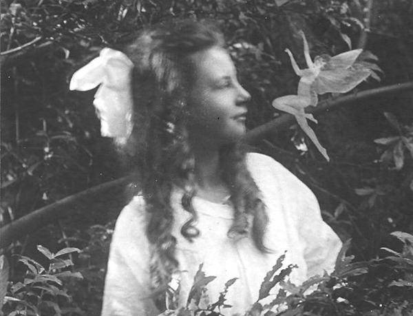 The Cottingley Fairies. The Cottingley Fairies appear in a series of five photographs taken by Elsie Wright and Frances Griffiths, two young cousins who lived in Cottingley, near Bradford in England. In 1917, when the first two photographs were taken, Elsie was 16 years old and Frances was 10. The pictures came to the attention of writer Sir Arthur Conan Doyle, who used them to illustrate an article on fairies he had been commissioned to write for the Christmas 1920 edition of The Strand Magazine. Conan Doyle, as a spiritualist, was enthusiastic about the photographs, and interpreted them as clear and visible evidence of psychic phenomena. Public reaction was mixed; some accepted the images as genuine, but others believed they had been faked. Interest in the Cottingley Fairies gradually declined after 1921. Both girls grew up, married and lived abroad for a time. Yet the photographs continued to hold the public imagination; in 1966 a reporter from the Daily Express newspaper traced Elsie, who had by then returned to the UK. Elsie left open the possibility that she believed she had photographed her thoughts, and the media once again became interested in the story. In the early 1980s Elsie and Frances admitted that the photographs were faked using cardboard cutouts of fairies copied from a popular children's book of the time, but Frances continued to claim that the fifth and final photograph was genuine.