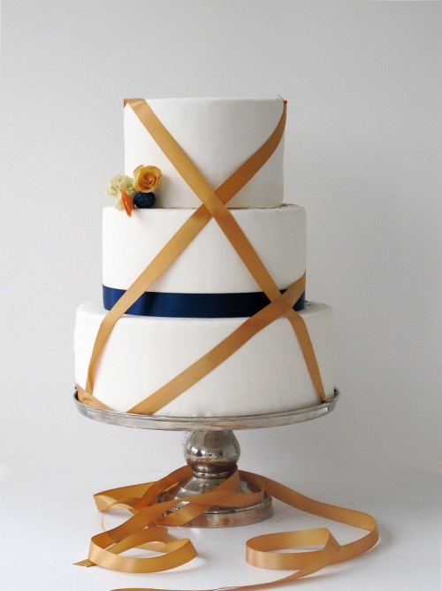 Wrapped ribbon? Simply exquisite. CATEGORY: Wedding Cake CREDIT: Maggie Austin Cake