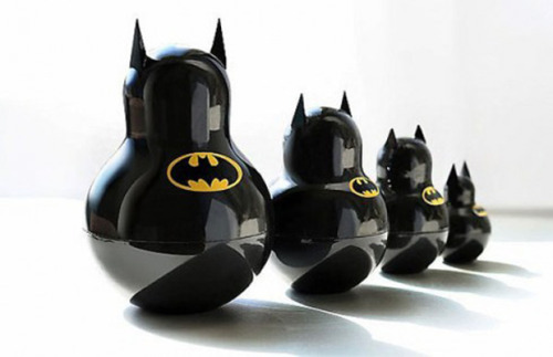 "freshmensalley:  ""Batman"" Russian Nesting Dolls Katya Malkhova is the Russian graphic designer and photographer behind this fun collection of ""Batman"" inspired Russian nesting dolls. The chotchkies are neatly concealed within each doll. Open one up and find a smaller version of Batman inside. Hit the thumbs to check out these fresh ""Batman"" Russian nesting dolls in detail. [JayMug]"