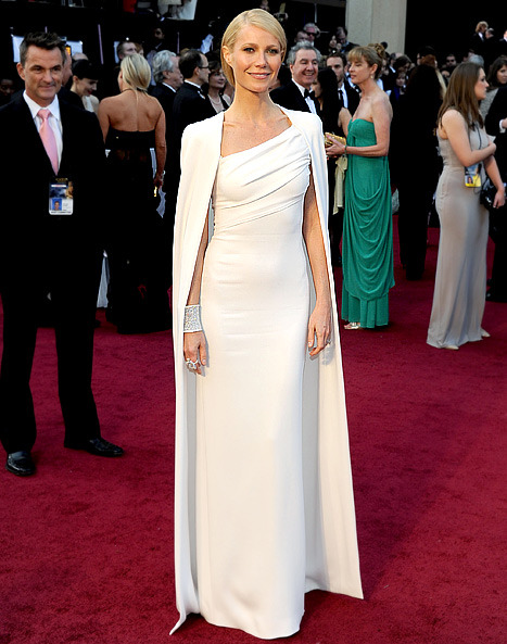 Style Inspiration- Gwyneth Paltrow in Tom Ford at the Oscars I'm never shocked when I see women in gowns. My reaction is usually oh that's nice or she looks gorgeous. When I saw Gwyneth in this number I said WOW. I don't think anyone else could've pulled this off. She has the height and the frame for this. The cape is absolutely exquisite. The low slung simple ponytail and neutral makeup pulled everything together. This is a memorable look. LOVED IT!!!!!!!!! ***Photo courtesy of www.usmagazine.com****
