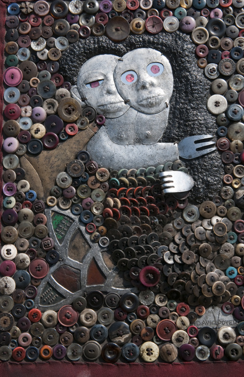 "Buttons + Forks + A whole bunch of other crap = ""Recycled Art"""