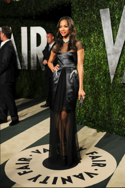 "Zoe Saldana in Marios Schwab. When I looked through his collection and saw this dress I kept thinking ""This better pop up somewhere, this better pop up somewhere"" and it did! And on who better than Zoe Saldana? With soft waves, beautiful dark eyes, and a red lip she looks flawless."