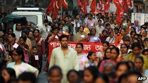 India strike: Millions expected to take part Millions of Indian workers are expected to join a strike against high inflation and to demand better working conditions and an end to selling off state firms. The strike has the support of most of India's major trade unions and thousands of smaller unions from across the political spectrum. Banks, transport, post offices and ports are thought most likely to be affected by the industrial action. But services on India's rail network are not expected to be disrupted. Although India's inflation rate dropped from 9.1% in December, it remains stubbornly high at 7.5%. Growth for the financial year ending in March is also expected to be around 7%, lower than the previous forecasts of about 9%. The government of Prime Minister Manmohan Singh is trying to cut its budget deficit by selling stakes in state-run companies - something the unions object to. Other demands include measures to curb inflation, universal social security cover for non-unionised workers and enforcement of labour laws. Pictured: Unions want universal social security cover for workers in India's vast unorganised labour sector