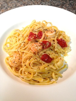 Shrimp Linguini in a Lemon and Roasted Tomatoes Sauce 4 to 6 servings Ingredients  1/2 cup extra-virgin olive oil 1 lemon, zested 20 to 30 cherry tomatoes, roasted at 225 degrees in oven for three hours 1 pound linguine pasta 2 tablespoons olive oil 2 shallots, diced 2 garlic cloves, minced 16 ounces frozen shrimp 1/4 cup lemon juice (about 2 lemons) 1 teaspoon salt 1/2 teaspoon freshly ground black pepper 1/4 cup chopped fresh flat-leaf parsley   Directions ** For the lemon oil: **Combine the olive oil and the lemon zest in a small bowl and reserve. ** **For the pasta:Bring a large pot of salted water to a boil over high heat. Add the pasta andcook until tender but still firm to the bite, stirring occasionally, about 8to 10 minutes. Drain pasta, reserving 1 cup of the cooking liquid.Meanwhile, in a large, heavy skillet warm the olive oil over medium heat. Addthe shallots and garlic and cook for 2 minutes. Add the shrimp and cook untilpink, about 5 minutes. Add the cooked linguine, lemon juice, lemon zest, salt,and pepper. Toss to combine. Add the roasted tomatoes. Using amesh sieve, strain the lemon zest out of the reserved lemon olive oil and addthe oil to the pasta. The zest can be discarded. Add some of the cooking waterto desired consistency. Add the chopped parsley to the pasta and toss tocombine. Serve immediately.