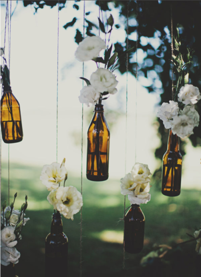 weddingdaydreams:  Do it yourself decor at weddings is so unique and pretty. Use empty wine and beer bottles as a vase!