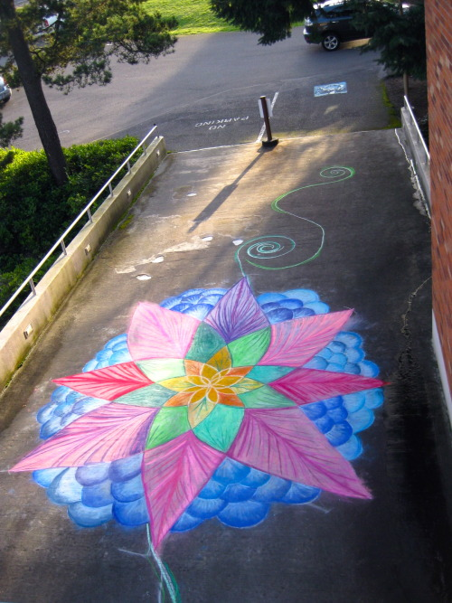 A school project. Large chalk mandala on the ramp to the art therapy building.