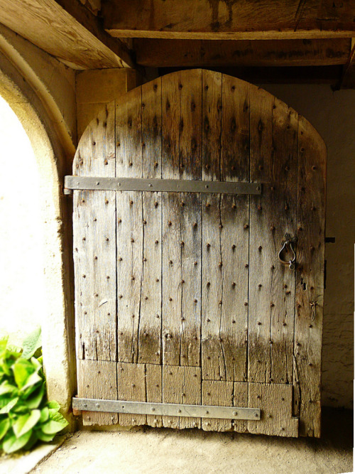 bewitchingbritain:     Tudor door to the brewery at Lacock Abbey, Wiltshire, England. The abbey was founded as an Augustinian nunnery  in the early thirteenth century by Ela, Countess of Salisbury. (Elizabeth C on flickr)    Door porn makes me very very happy. And my husband just handed me my passport, which he had locked up in the fireproof security box, of all places.