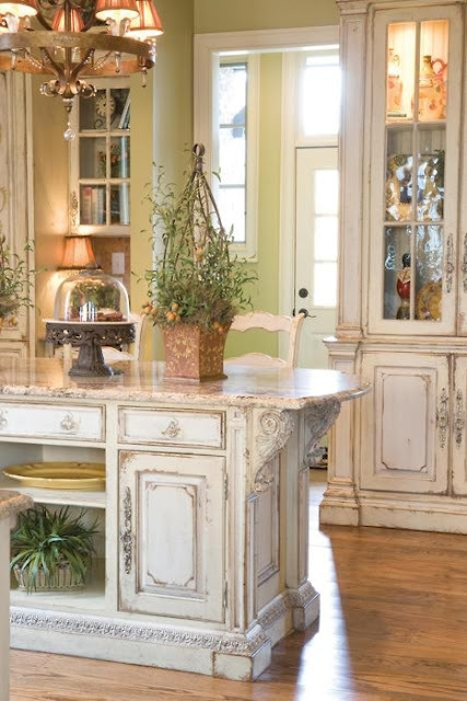 This rustic but ornate design for a kitchen looks so homey!
