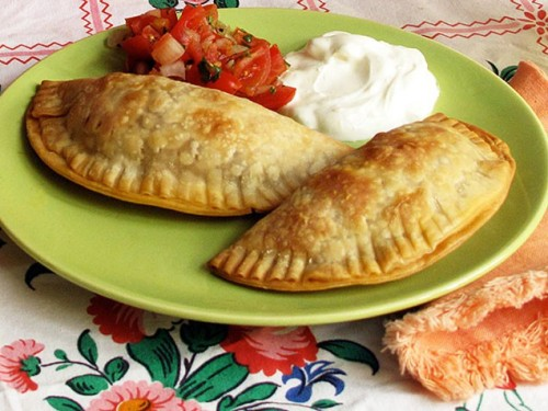 Beef Empanadas You might think empanada-making is best left to the pros, but this recipe uses frozen store-bought empanada dough so all you have to do is fill them with a tasty ground beef mixture and bake! Get the recipe!