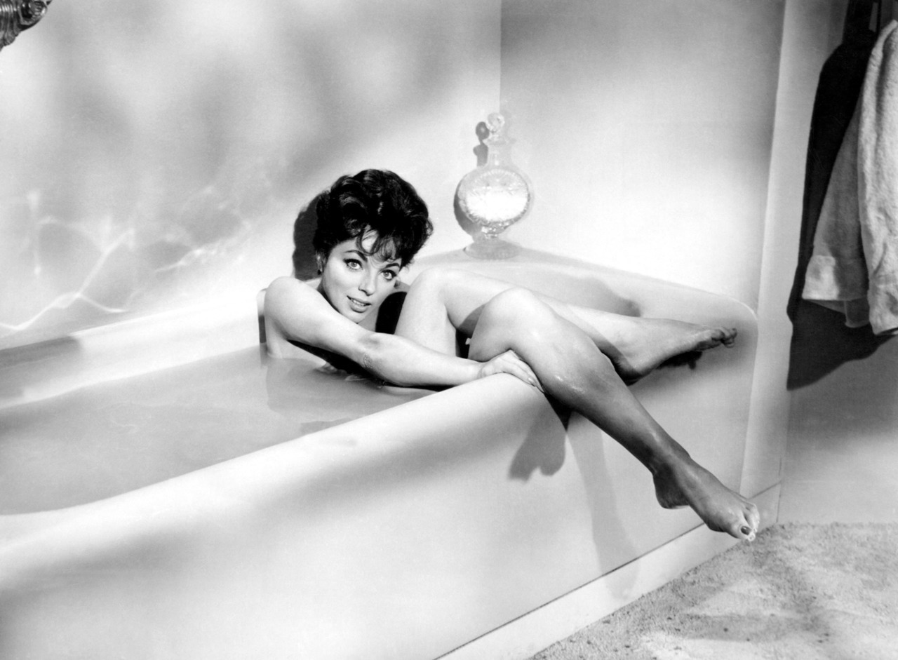 "In Writers Gone Wild on Feb. 29, Joan Collins won a major victory in her lawsuit against Random House when a judge awarded her an extra million bucks on top of the $1.3 million she was already given. Collins had signed a two-book, $4 million contract with the publishing house and had turned in two manuscripts that Random House rejected as unpublishable. The company then sued to get back its $1.3 million. (The photos is from a scene in ""Rally Round the Flag Boys."" It has nothing to do with the lawsuit, but let's face it, wouldn't you rather see this instead?)"