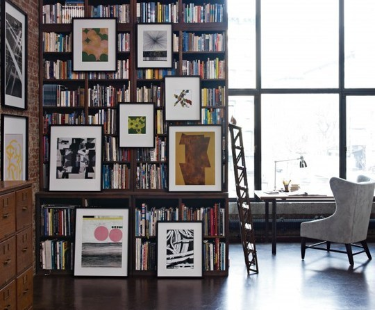 Fuck your picture frames hanging from your bookcase in front of your books.