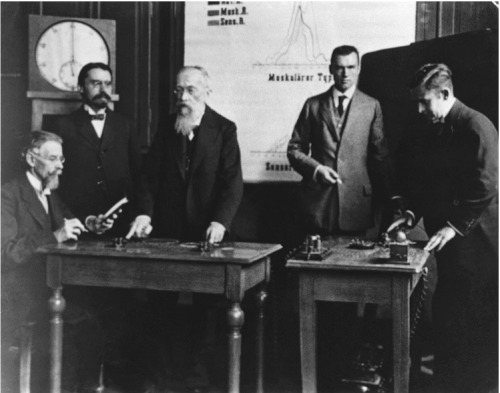 "Wilhelm Wundt (standing, with gray beard) and colleagues. Wilhelm Wundt (1832-1920) was a German physician, psychologist, physiologist and philosopher, known today as the ""father of experimental psychology"". He wrote Grundzüge der physiologischen Psychologie (1874) [Principle of Physiological Psychology] and founded the first formal laboratory for psychological research at the University of Leipzig."