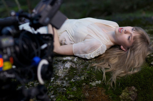 "This is a Taylor Swift post: On the set of ""Safe & Sound."" [pics]"