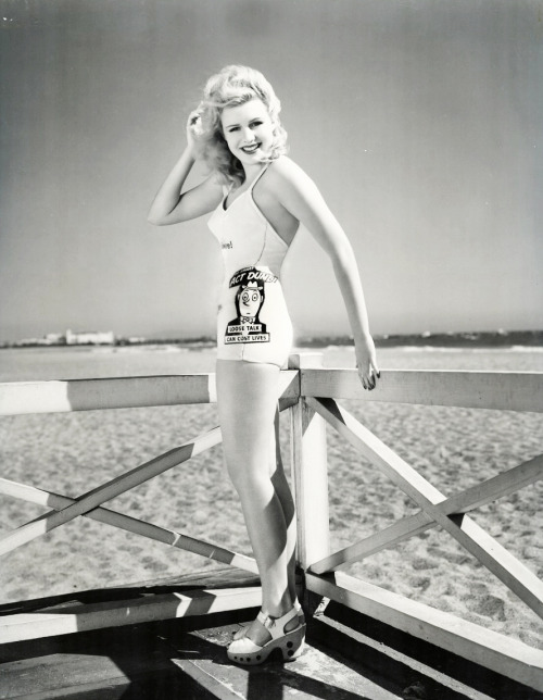 "Majorie Woodworth wears a WW2 propaganda swimsuit that reads : ""Be smart, act dumb. Loose talk can cost lives."" c. 1940's"