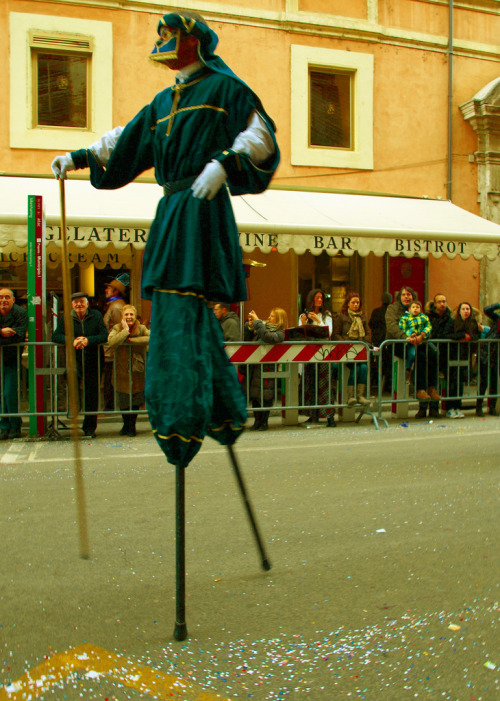 stjglobal:  Carla Spensieri/Rome, Italy The parades in Italy are different from New York parades. There are no floats. In fact, there are actually row after row of horse riders. These horse riders represent different associations, cultural clubs, and other groups. Pictured here is one of the medieval style stilt walkers who preceded the big group of horses and their owners.