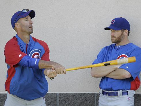 New Cubs manager Dale Sveum shows Ryan Dempster how he earned his .236 lifetime average. Dempster silently hates every moment. (Photo courtesy of USA Today and copyright Morry Gash/AP) -ə