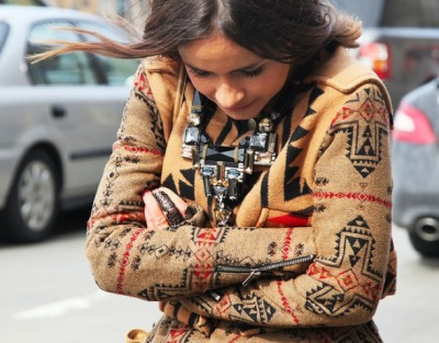 A native print and statement necklace add the perfect amount of chic to her winter garb.