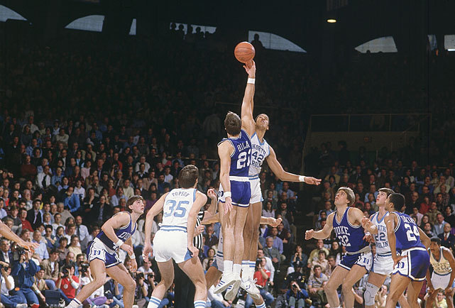 North Carolina's Brad Daugherty and Duke's Jay Bilas tip off a 1985 game between the Tar Heels and Blue Devils. (Jerry Wachter/SI)  GALLERY: Duke vs. North Carolina Classic Photos