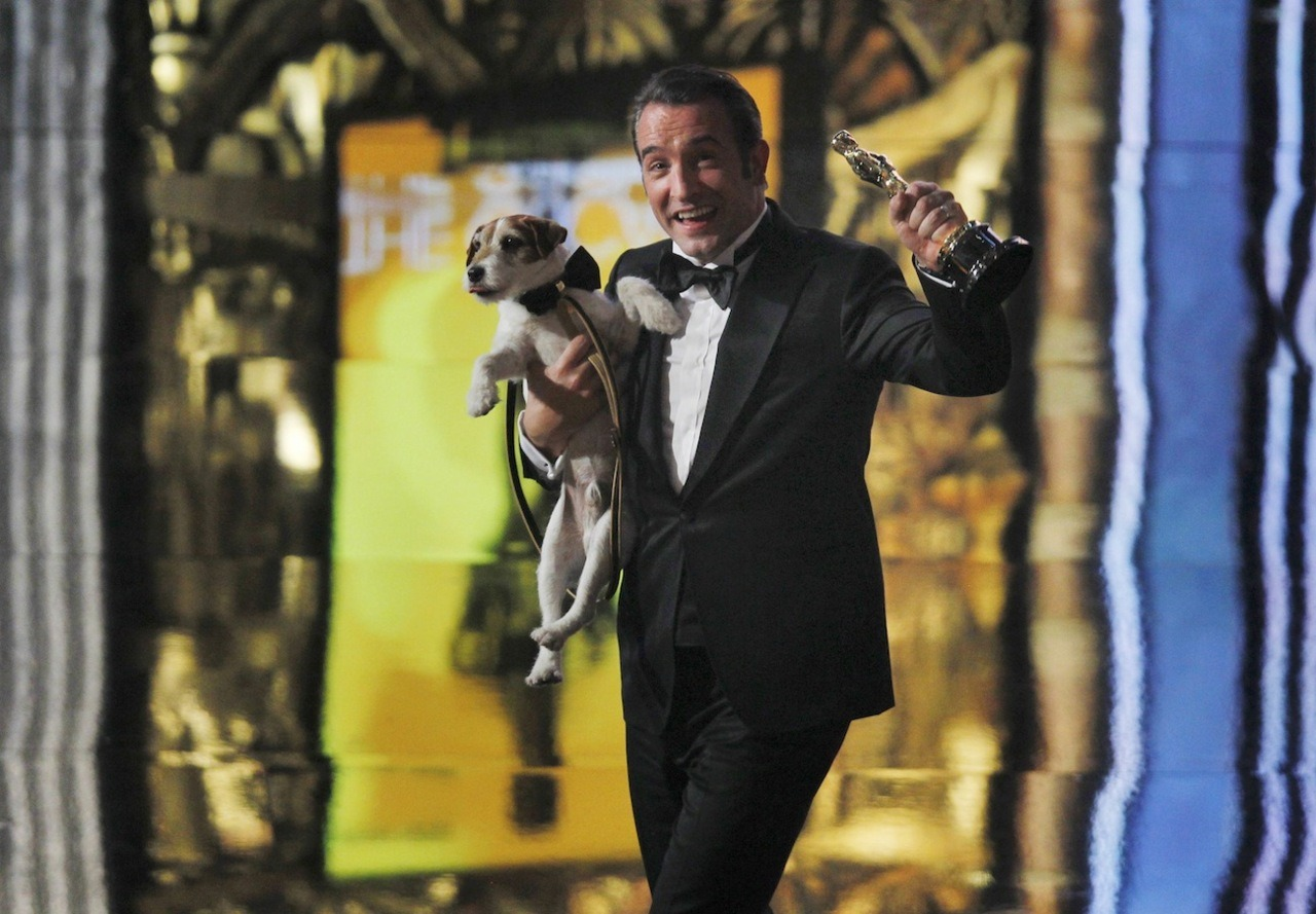 Jean Dujardin (holding his Best Actor award) onstage with Uggie the dog after The Artist won Best Picture at the 84th Annual Academy Awards on February 26, 2012. I LOVE IT! :-)
