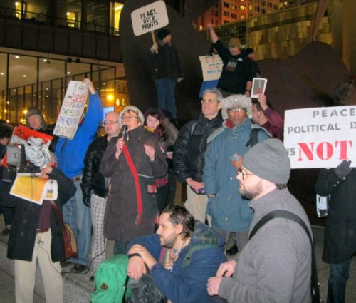 Members of Occupy Chicago rally at the Picasso in Daley Plaza for the February 28th nationwide Occupy solidarity demonstration.