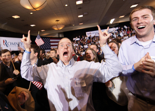 This photo tells you everything about the mood at Mitt Romney's Michigan headquarters tonight. Here's the candidate's third cousin, Miles Romney, dancing near the candidate's lectern here in Novi, Mich., after it was announced the ex-Massachusetts governor won Arizona (Photo by Gerald Herbert/AP)