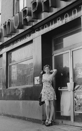 A prostitute poses in Times Square in the 1950s.