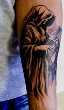 fuckyeahtattoos:  This is my Tattoo of Destiny from the Sandman comic books series by Niel Gaiman (which I absolutely love), although Destiny is not new to the Sandman series. Michael Spades of Dermagraphic Studios in Texarkana, Texas did the ink. I got this tattoo for several reasons, a couple of unexpected ones. A friend once upon a time told me that I reminded her of Destiny from the Sandman. At that point I had never heard of the comic. She showed me a picture of Destiny and I fell in love before I knew anything about him. The idea of being chained to a book caught my attention, because I always had an affinity for academia, literature, and knowledge. Turns out that the Sandman is an exploration into a number of different intellectual fields. I thought that was a perfect reflection of who I am.Another reason why I got the tattoo was as an exploration of the idea of Destiny and fate. Although I don't buy into those ideas, it is hinted in the comic book that each of the Endless (entities in the Sandman that represent human psychological embodiments) manifest the opposite of their embodiment, thus being chained represents the idea of freedom. In a way it tells the story of a psychological battle, or a play of opposites, much as represented in Chinese Taoism. This was the clincher.Destiny in the series is blind, but somehow he is still able to acquire knowledge from the book, referred to as the Cosmic Log or Book of Destiny. It contains all the past, present, and future events of every human. These were some other cool ideas that drew me into the character. Overall, I am super happy I had the tattoo done, and the art and detail turned out really good. The placement is on my forearm.