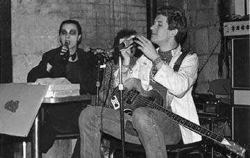 "At a performance at the Rat 1977. The members of the Damned sit and eat pizza as they perform saying "" Yo"