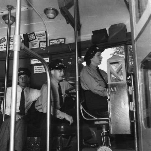 Esther Bubley, An instructor of the Capitol Transit Company teaching a woman to operate a one-man streetcar, Washington, DC, June 1943. Source: Library of Congress