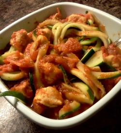 "Zucchini spaghetti! New favorite paleo dinner. Slice up a zucchini into ""noodles"", put into boiling water for one minute, then rinse with cool water. I added pasta sauce and some ground turkey for yum-yum-yumness."