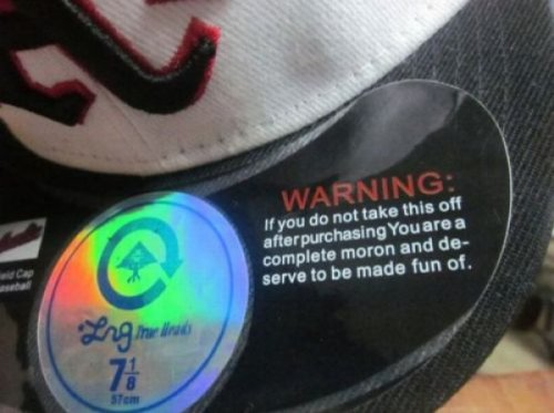 Fitted Hat Sticker Warning   You'd also be depriving the garbage of a cool sticker—just like your older brother did to you. Break the cycle, people. Break the cycle.
