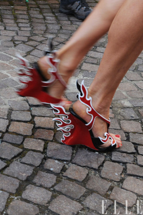 elle:  Follow those Prada flame shoes! Check out more action from the streets of Milan here! Photo: IMAXtree