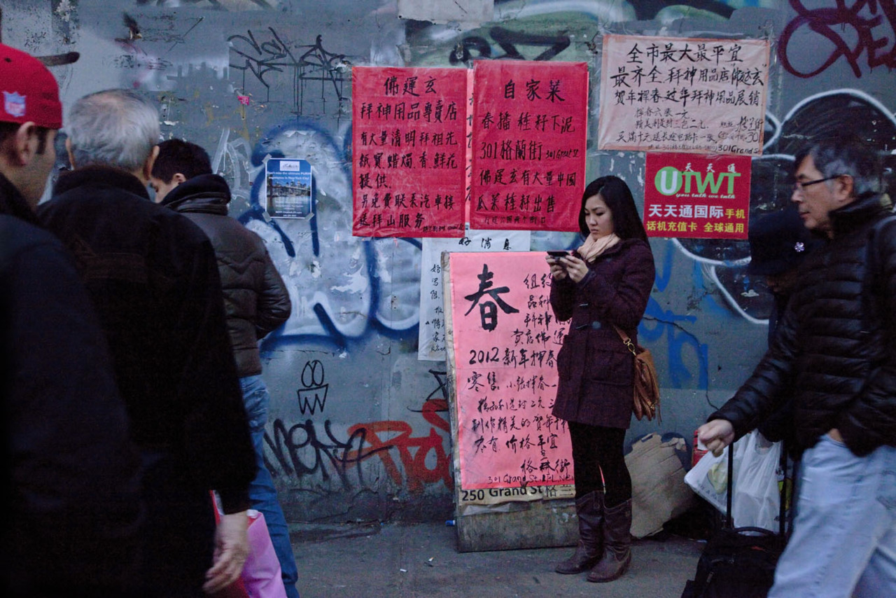 Lets communicate: graffiti, pamphlets & posters, texting… At dusk, Chinatown in Manhattan. Photographed Feb. 28, 2012 photo credit & copyright Gary Dwight Miller