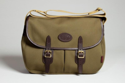 John Chapman 'Flyfisher' Bag Straight out of Carlise, England comes John Chapman and his Spring 2012 'Flyfisher' bag, a shoulder slinger that mixes classic aesthetics with handmade quality. Canvas, tweed, leather and brass combine to create this compact bag with a very military feel, staying true to traditional functionality that any decent bag should have. Although it seems built for mining streams for fish gold, this versatile bag fits in just as well in the blacktop jungle.