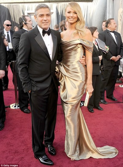 Stacy Keibler dazzles at the Oscars in her stunning gold Marchesa gown and side swept waves. To give your hair a dazzling shine, apply a shine spray (like Macadamia's Healing Oil Spray) to hair. #Macadamia Natural Oil