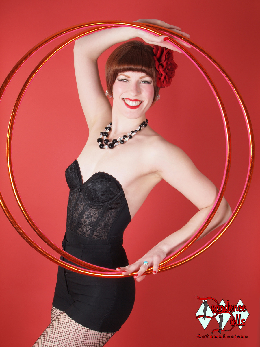 Hoop Pin-Up! This shot is from my photo shoot with pin-up photographer Autumn Luciano for Drive-In Magazine! Stay tuned for for the release date. The photo features yours truly and my orange and pink polypro minis from my line, Audacious Hoops, featuring premiere quality hula hoops. www.audacioushoops.com www.decadencedolls.com www.magcloud.com/user/driveinmagazine
