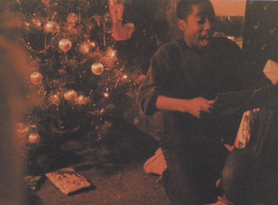 ineedsomeunderstanding:  thetpr:  hiphoplaboratory:  Young Tupac on Christmas  This picture is too dope haha  I love you tupac ,<3