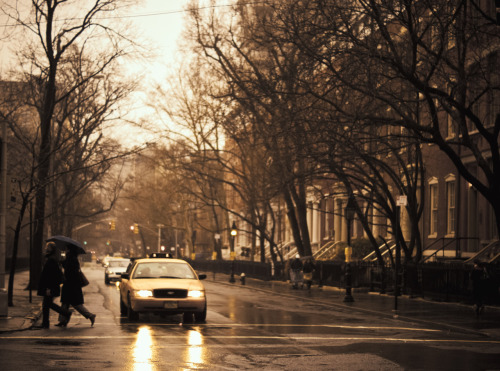 "Rain in Greenwich Village, New York City.  In dreams memories take on the hues of nostalgia: faded hues made rich with meaning that are etched into the dreamscapes that play themselves against our eyelids each night.  Memory-tones diffused by the tear-in-the eye and lump-in-the throat feeling of familiarity synthesize with overwhelming feelings of connection with the past as it dilutes itself into the present.    —-  View this photo larger and on black on my Google Plus page  —-  Buy ""The Color of Rain - Greenwich Village - New York City"" Posters and Prints here, email me, or ask for help."