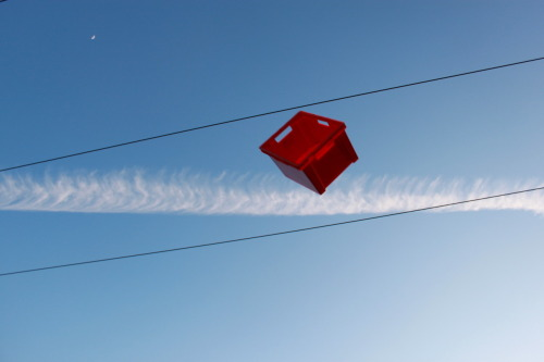 29/02/12-Throwing a red box at telephone wires.