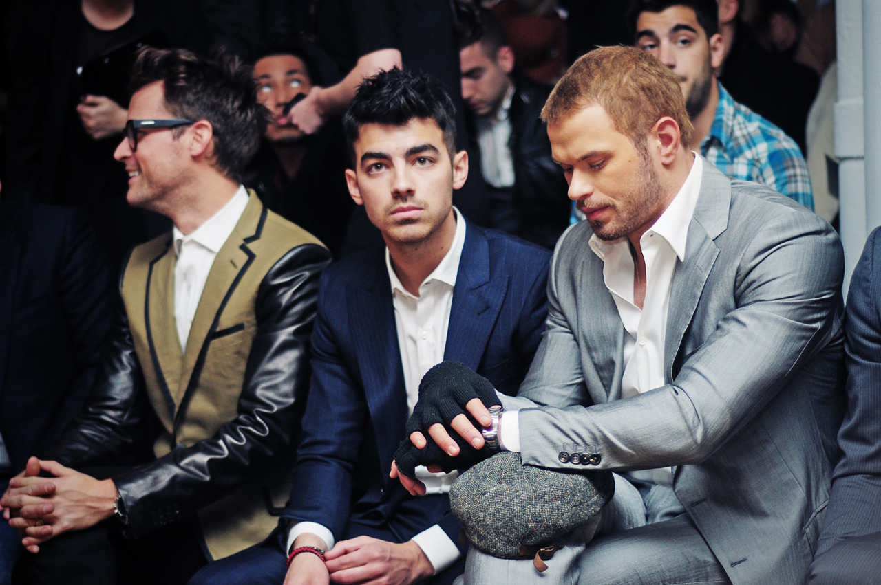 Brad Goreski, Joe Jonas, and Kellan Lutz at the Simon Spurr runway show in Milk Studios