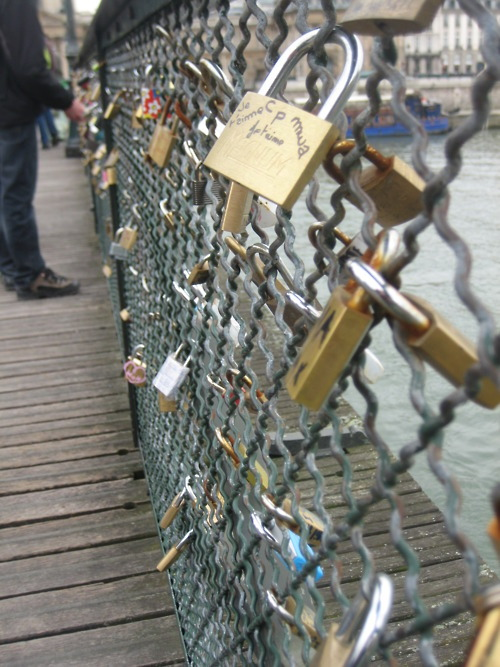 m-ediocre:  This is a bridge in Paris. You hang locks on it with the name of you & your boyfriend/girlfriend/best-friend then throw the key into the river. So even though the friend/relationship may end, you can't remove the lock. It stays there forever, as relevance to someone once a part of your life.